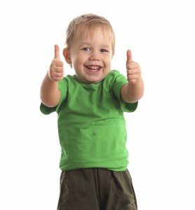 Little child with two thumbs up