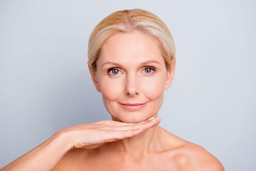 Pretty, attractive, charming, woman demonstrate, show, present her perfect skin after botox